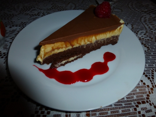 Mousse cake served with coulis