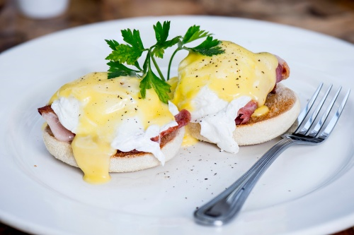Eggs Benedict with poached egg, bacon, muffin and Hollandaise sauce