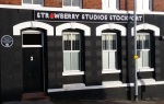 Newly updated Strawberry Studios Stockport sign and blue plaque