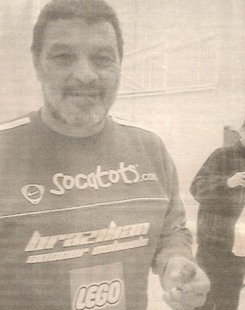 Brazil legend Socrates with a Tino Asprilla figurine